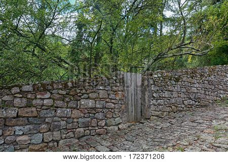 Old stone wall and door in the town of Largentiere in the Ardeche region of France