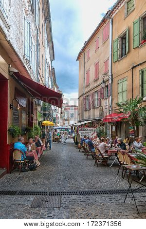 Les Vans, France, September 17, 2015: Image of restaurants in a streets in the center of Les Vans in the Ardeche region of France