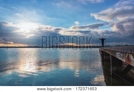 Man enjoys the spectacular sky over Lake Veere in the Zeeland province of the Netherlands