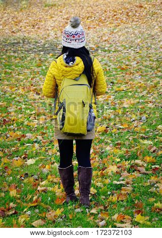 A woman walking at the park in autumn