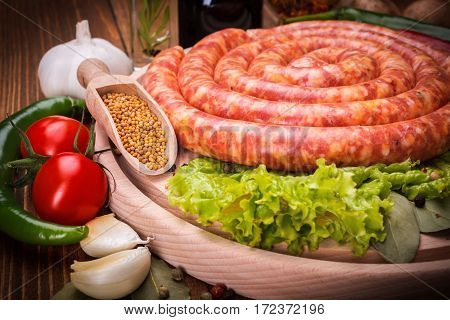 Pork Sausage Along Vegetables And Spices