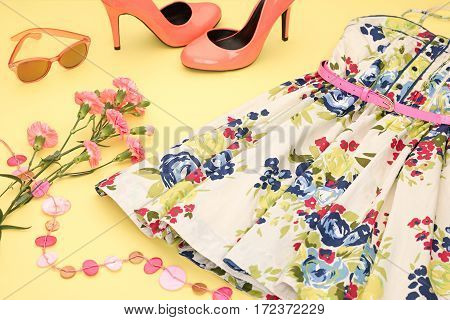 Fashion Summer girl clothes Set, Accessories. Outfit. Stylish Floral Dress, Trendy fashion Sunglasses, flowers. Glamor shoes Heels. Summer lady Essentials. Creative Design.Pastel. Fashion Urban Concept