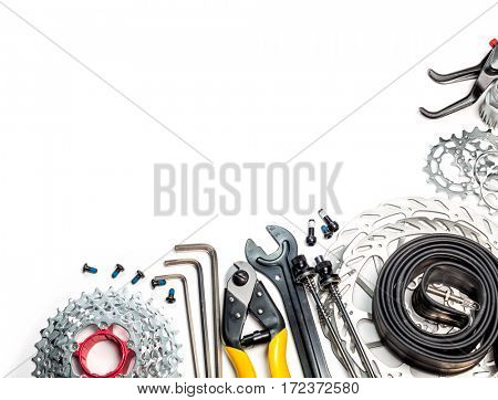 Mountain bike spares  cassette gear skewers brake disk rotors levers tube sprockets and tools allen keys cable cutter on white background
