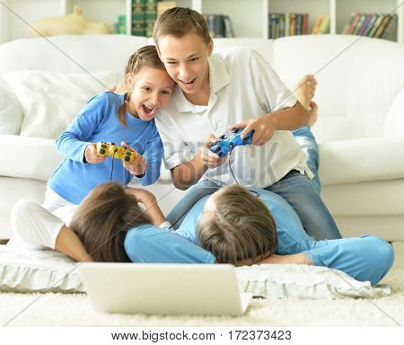 Portrait of a kids playing computer games at home