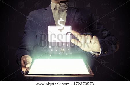 Image of aman with a tablet in his hands. He touches purse icon. online wallet concept storage online banking.