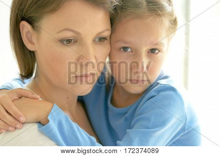 upset mother and daughter close up portrait