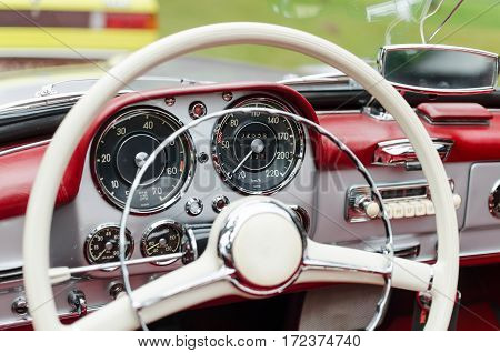 close up of a vintage sports car dashboard