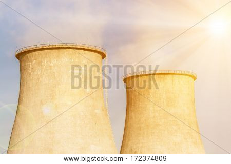 Close up of the cooling towers on the sky background