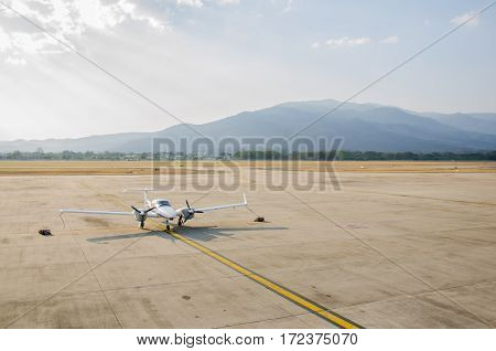 Small Airplane or Aeroplane Parked at Airport.Small Airplane Famous to use Private Airplane.Sun Light and Mountain View.