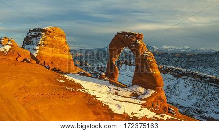 Snowy,  wide angle photograph of delicate arch