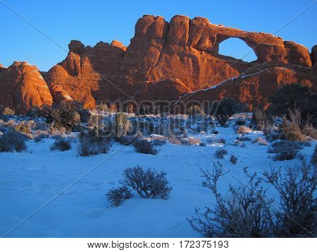 Winter snow at Skyline arch in Arches National Park