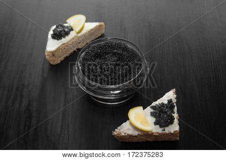 Black Caviar And Canapes On A Black Background