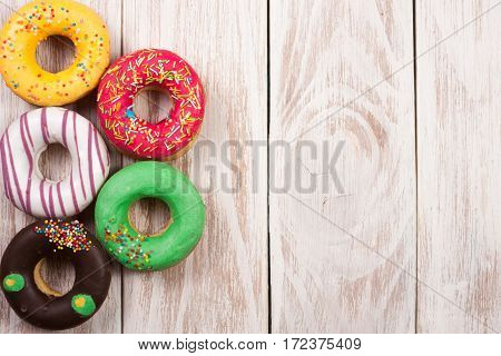 glazed donuts on a white wooden background with copy space for your text. Top view.
