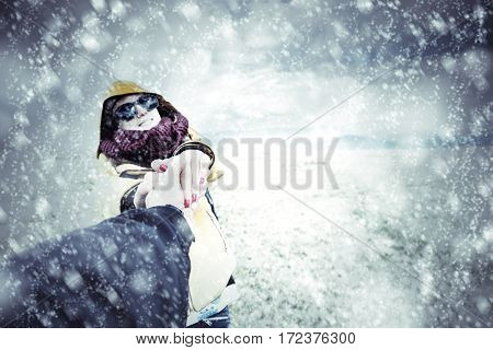 Couple enjoying on snow outside - optical focus is on the hands.