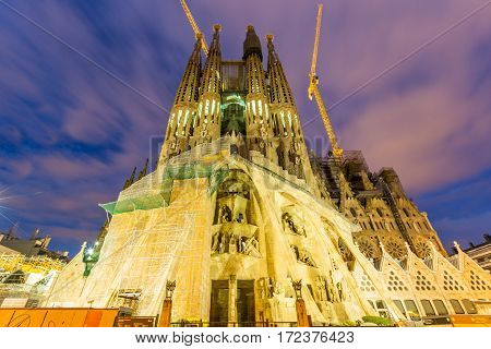 Barcelona, Spain - February 27, 2013: Sagrada Familia At Twilight. Designed By Antoni Gaudì, The Chu