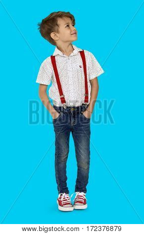 A Caucasian Boy Standing Looking Up Background Studio Portrait