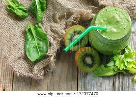 Green Smoothie Spinach, Celery And Kiwi Fruit In A Glass Jar.
