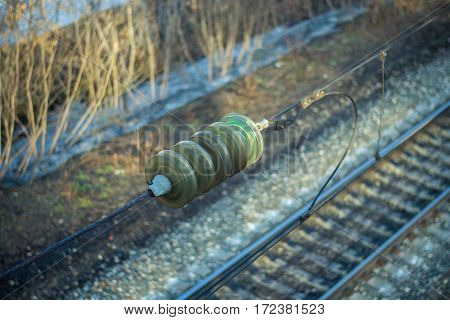Isolator on the transmission line over the railway. Overpass over the railway, Kirov, Russia.