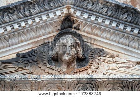 DUBROVNIK, CROATIA - NOVEMBER 29: Angel, portal of Saint Saviour Church in Dubrovnik, Croatia on November 29, 2015.
