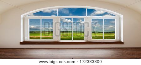 green field and blue sky with light clouds. view from the empty rooms on the beautiful fields and meadows.