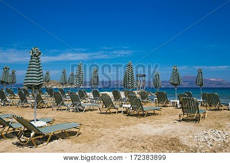 the opening of the tourist season there are empty deckchairs by the sea