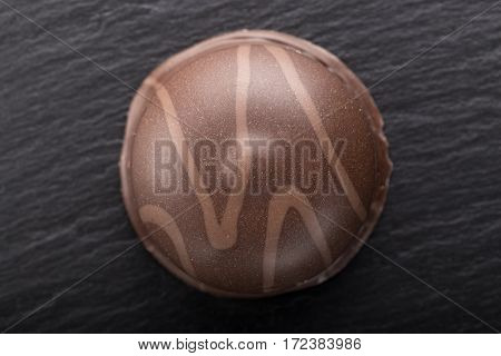 round chocolate candy on a black slate board