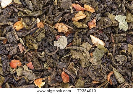 tea leaves Scatter green tea with fruit traditional Chinese drink