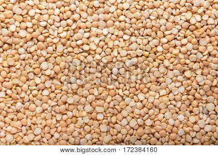 a lot of yellow peas are not cooked dry peas to cook nutritious meals vegetarian background