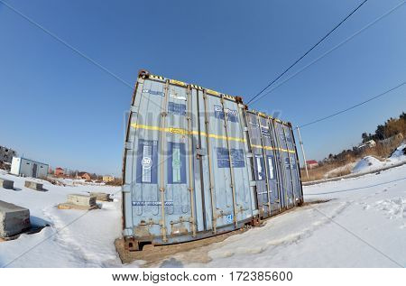 Countryside at winter. Shipping containers prepared for rebuilding to countryhouse.February 20,2017,Kiev, Ukraine