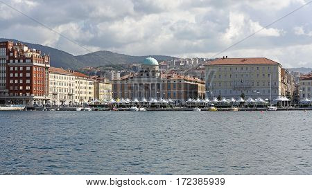 TRIESTE ITALY - OCTOBER 14: Waterfront Cityscape Panorama of Trieste on OCTOBER 14 2014. Panoramic Cityscape From Molo Audace Dock in Trieste Italy.
