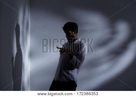 Man Pointing His Shadow