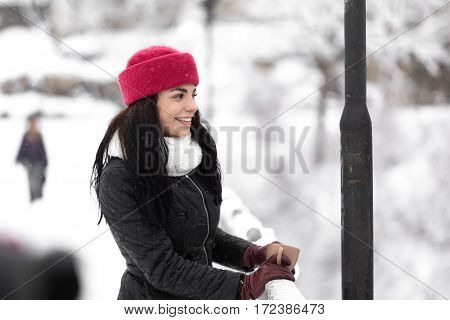 Gorgeous smiling female with cup of tea in hands