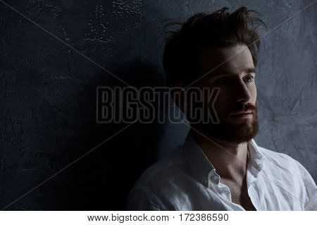 Sad Man Standing Against Wall