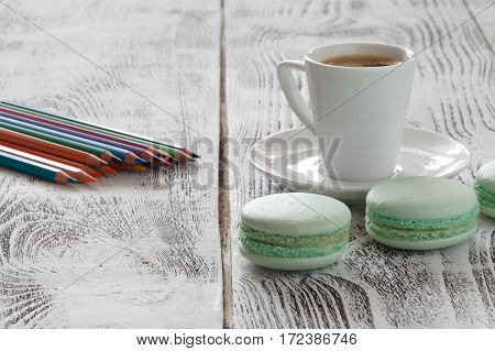 Coffee And Painter Utensils On Table