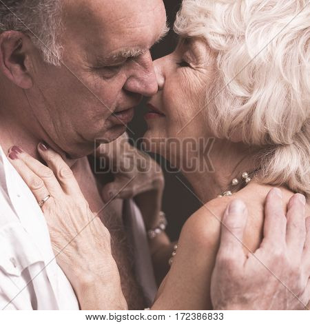 Senior Sexy Couple Kissing Softly