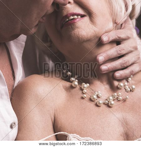 Senior Couple Kissing With Desire