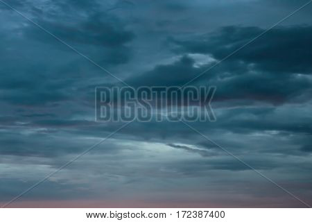 overcast gray and red evening sky for background