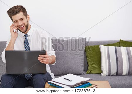 Smiling Young Telecommuter With Laptop