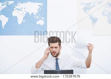 Irritated Businessman Talking On Phone