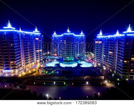 ALANYA, TURKEY - AUG 16, 2015: Three buildings of the residential complex Azura Park Residence at night, aerial photo