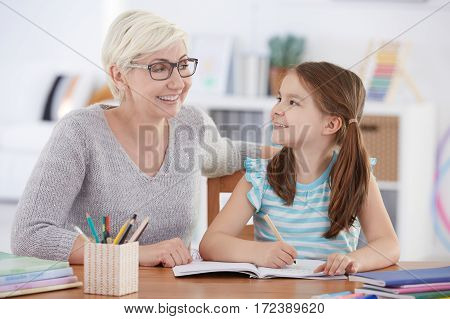 Girl Doing Homework With Tutor