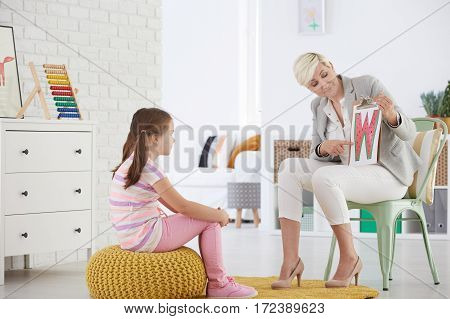 Girl Learning Reading Difficult Letters
