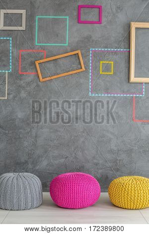 Three Poufs In Front Of A Wall