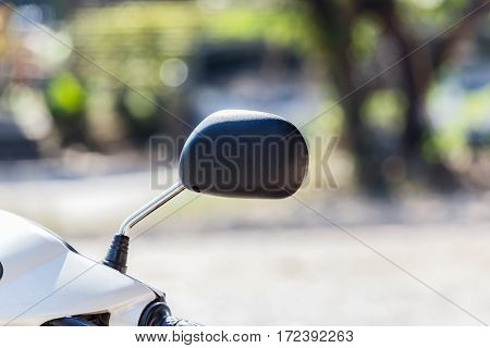 The Motorcycle rear view mirror. in nature background.