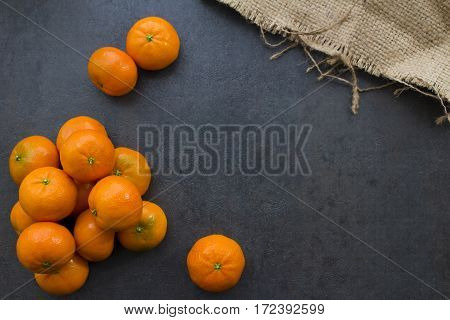 An overhead view of some mandarin oranges.
