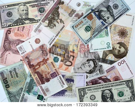 Banknotes of different countries and denomination arranged disorderly