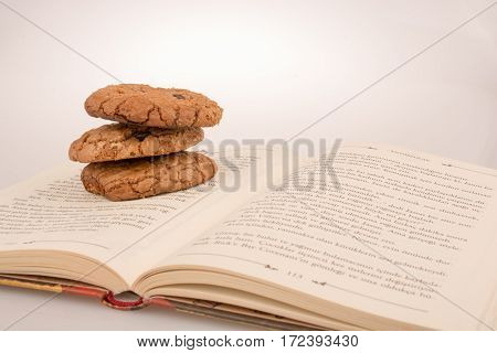 Chocolate Chip Cookie On A Book