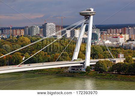 Bridge of the Slovak National Uprising with UFO restaurant over the river Danube. Bratislava, Slovakia.