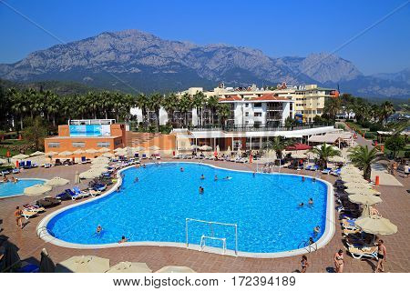 KEMER/ TURKEY - AUGUST 17. Territory of a luxury hotel wiht a big swimming pool on a mountains background on August 17, 2014. Kemer, Turkey.