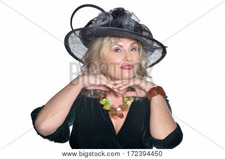 Senior woman in blouse smiling on white background